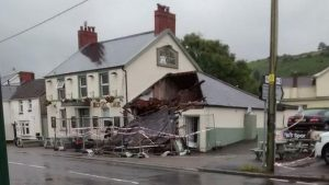 man smashes pub with digger