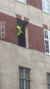 Window fitter in Londons West End risks 8 meter fall
