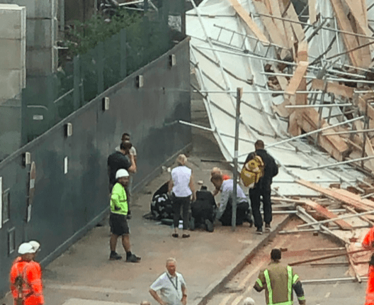 Three people injured in scaffold collapse