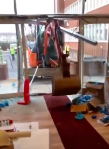 Digger driver smashes up travelodge