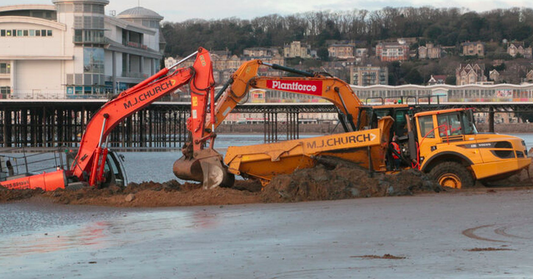 Two excavators attempting to remove tipper dumper